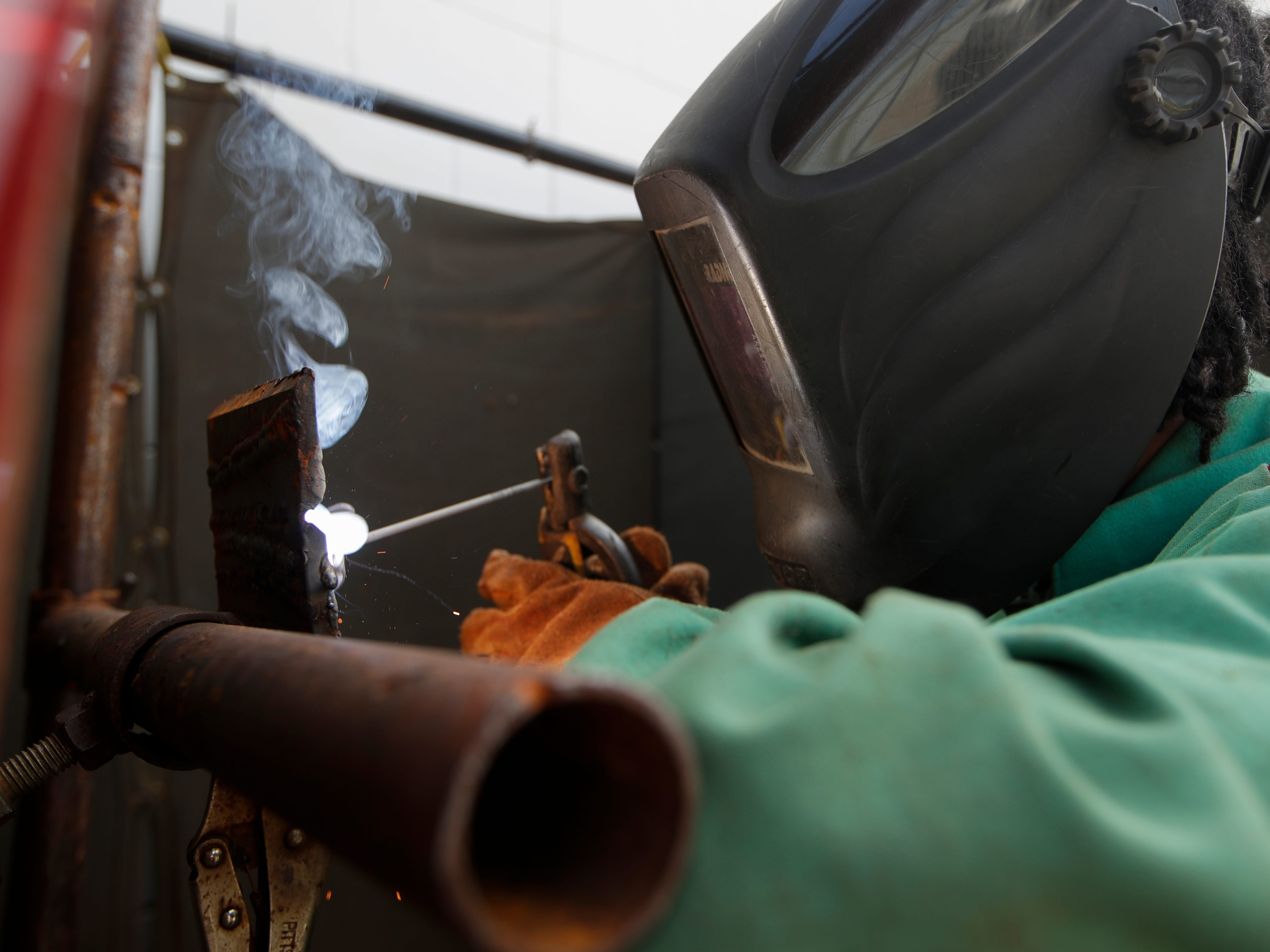 Godby High School student Marquel Ward, 17, practices a horizontal weld during a welding class Tuesday, Feb. 5, 2019.