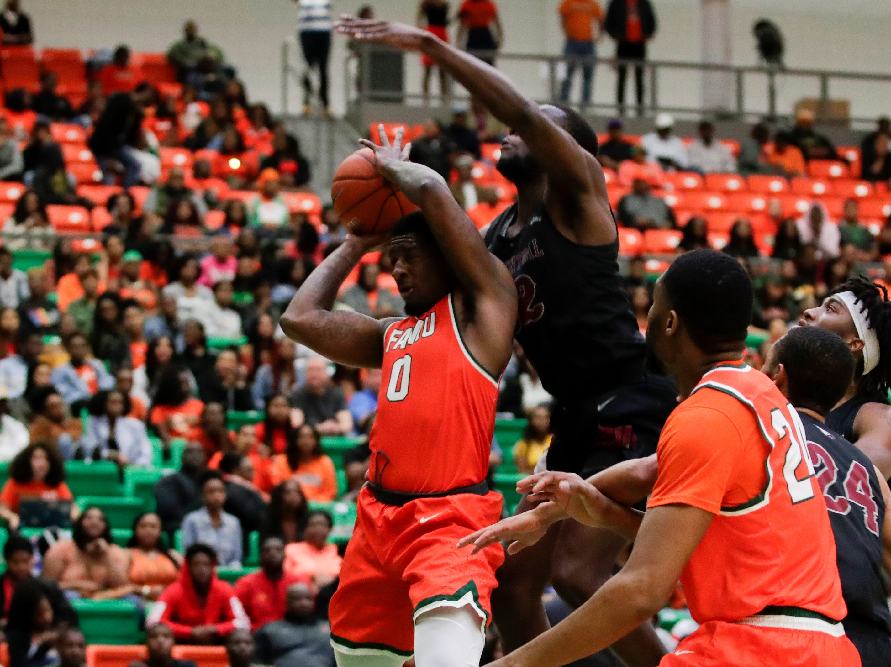 Florida A&M Rattlers forward Tracy Hector Jr. (0) gets fouled during a game between FAMU and North Carolina Central at the Alfred Lawson Jr. Multipurpose Center Monday, Feb. 4, 2019.