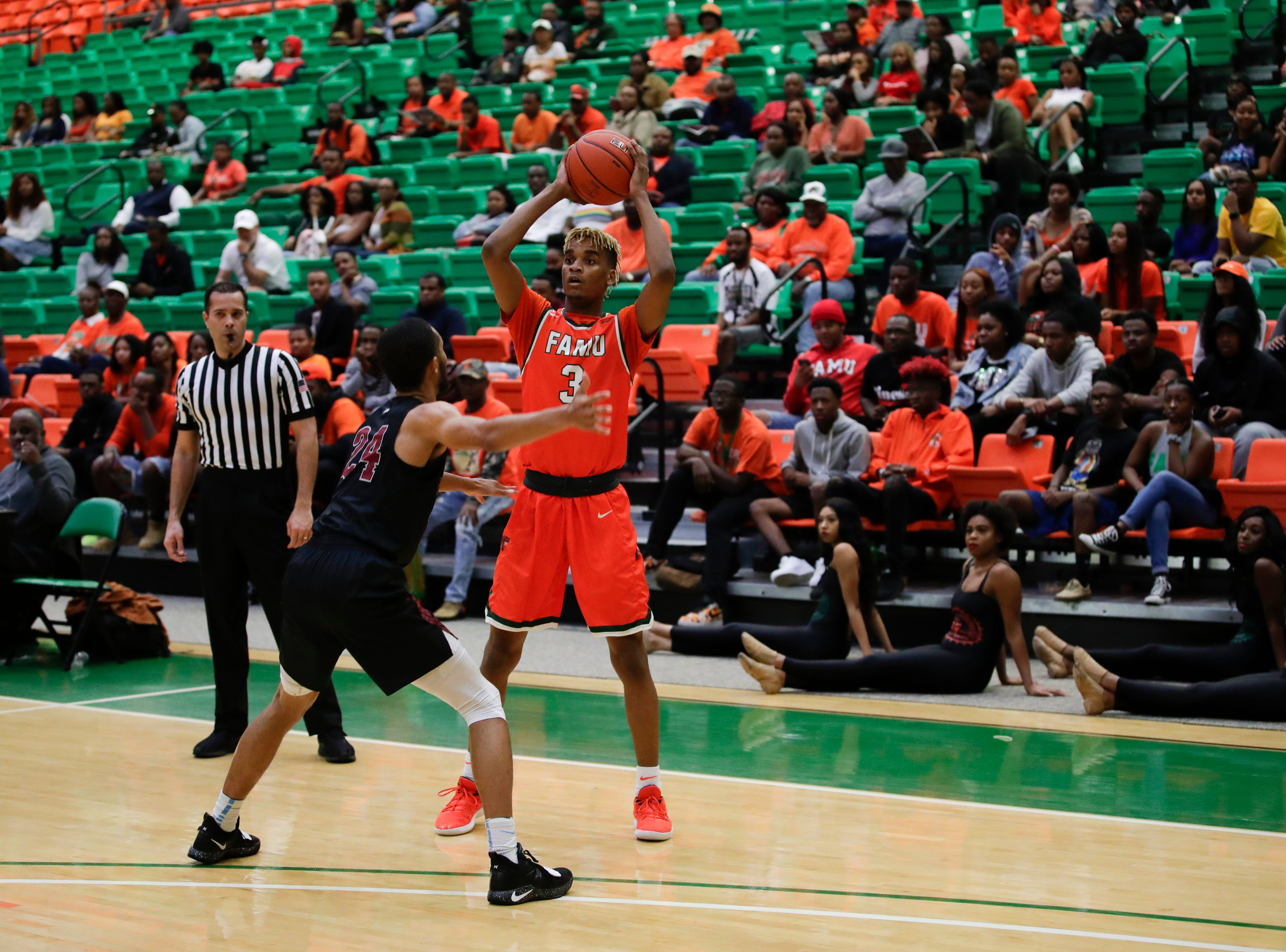 FAMU guard M.J. Randolph (3) looks for an open man during a game against North Carolina Central at the Alfred Lawson Jr. Multipurpose Center Monday, Feb. 4, 2019.