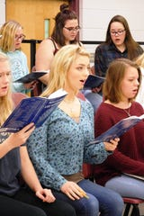 Casey-Marie Halstrom (center) and her choirmates have been rehearsing for months