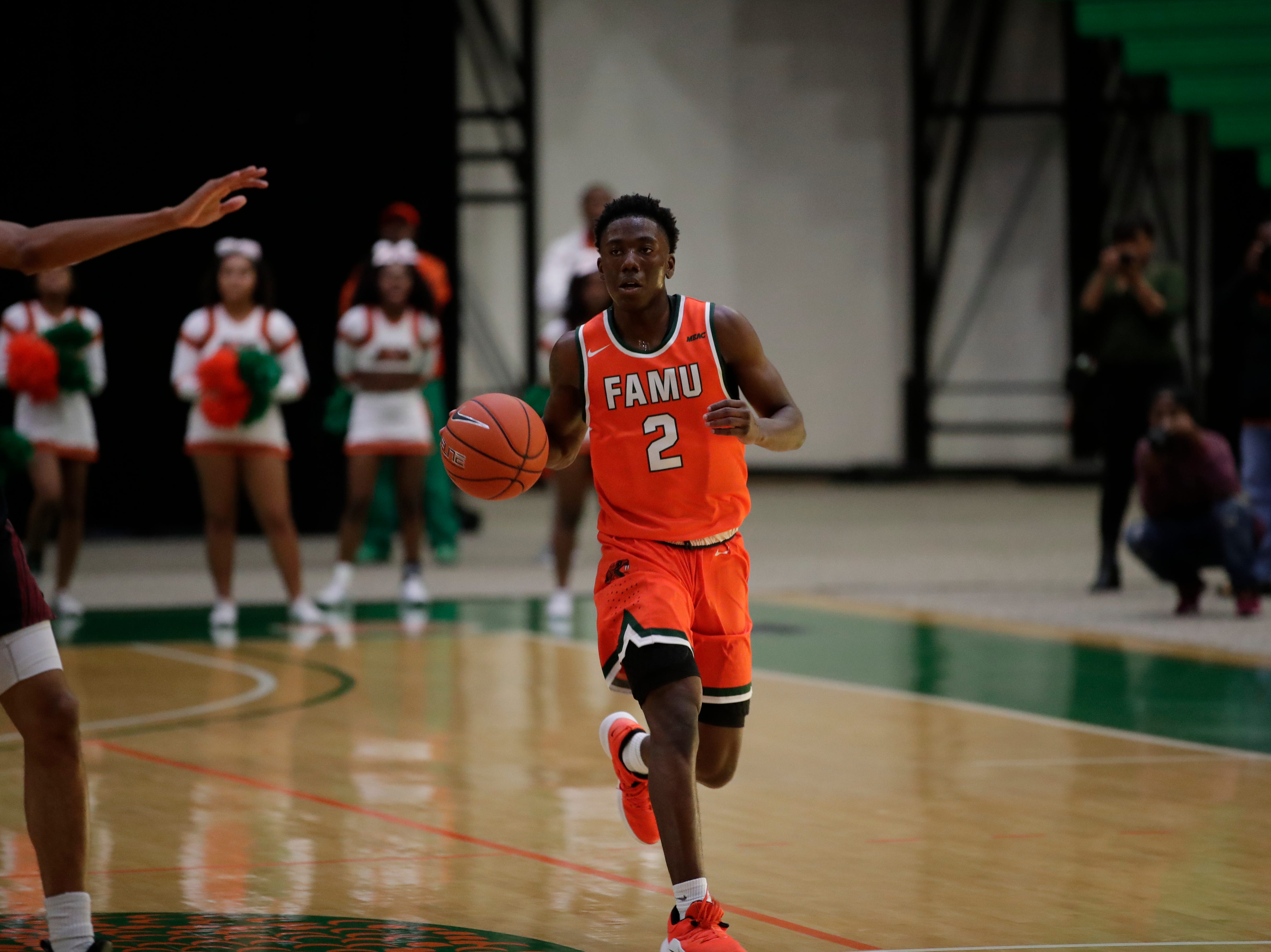 Florida A&M Rattlers guard Kamron Reaves (2) brings the ball up during a game between FAMU and North Carolina Central at the Alfred Lawson Jr. Multipurpose Center Monday, Feb. 4, 2019.