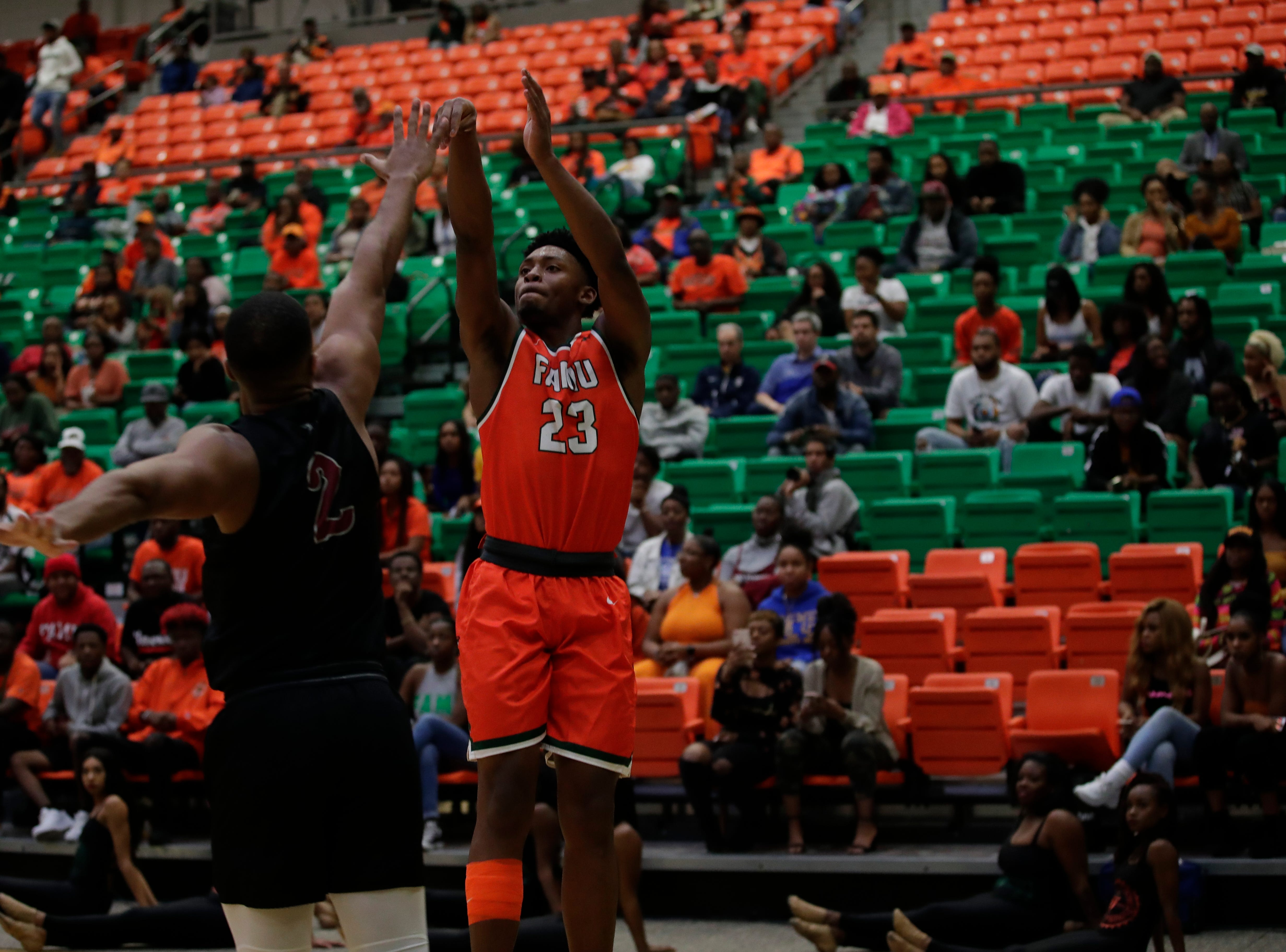 Florida A&M Rattlers forward Bryce Moragne (23) shoots a three-point shot during a game against North Carolina Central at the Alfred Lawson Jr. Multipurpose Center Monday, Feb. 4, 2019.