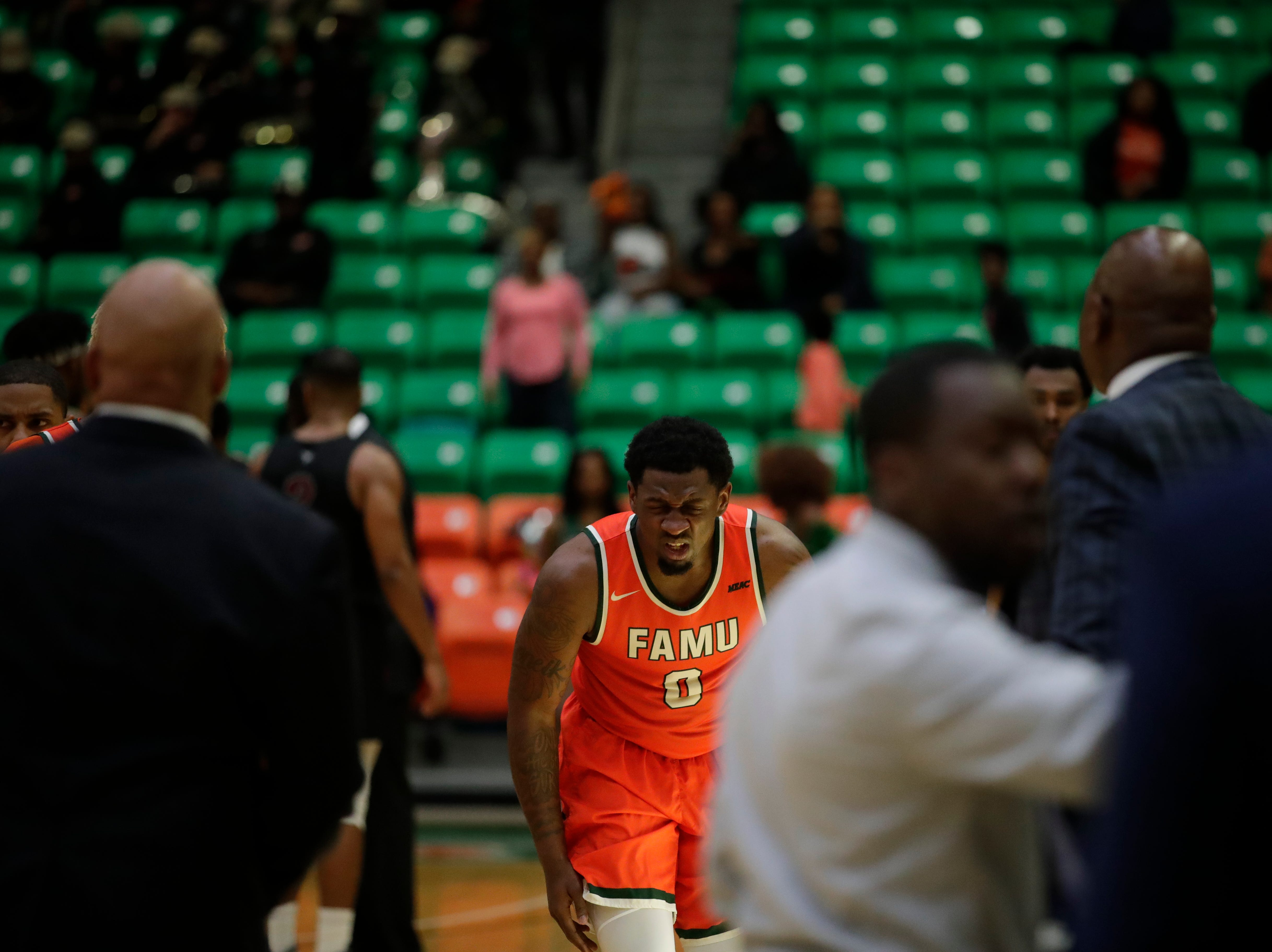 Florida A&M Rattlers forward Tracy Hector Jr. (0) winces after taking a hit to the eye during a game between FAMU and North Carolina Central at the Alfred Lawson Jr. Multipurpose Center Monday, Feb. 4, 2019.