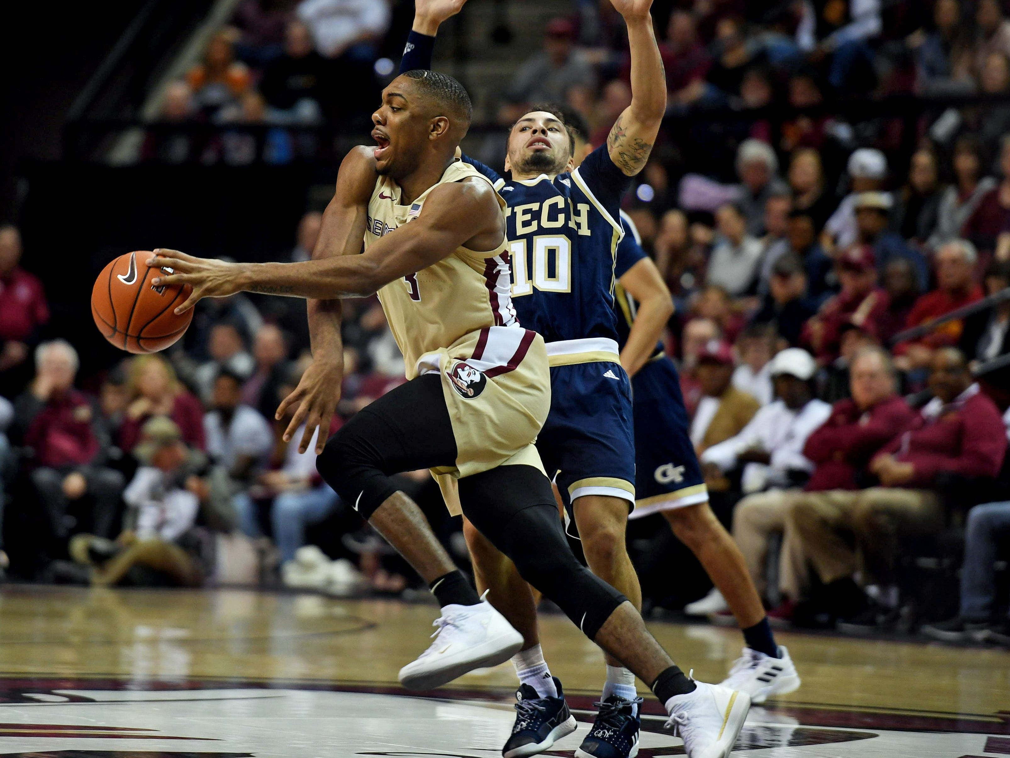 Feb 2, 2019; Tallahassee, FL, USA; Florida State Seminoles guard Trent Forrest (3) is fouled by Georgia Tech Yellow Jackets guard Jose Alvarado (10) during the second half at Donald L. Tucker Center. Mandatory Credit: Melina Myers-USA TODAY Sports