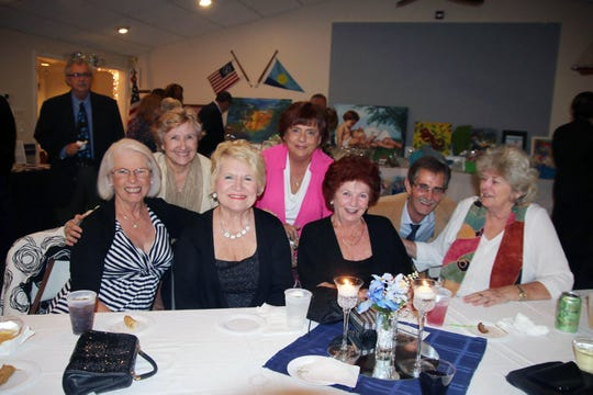 Celebrating the Dollars for Scholars fundraiser are, from left, seated, Terri Leone, Pat Bercier, Patty Rogers and Candace Banack; standing, Diane Hyre and Ingrid and Jim Van Hecken.