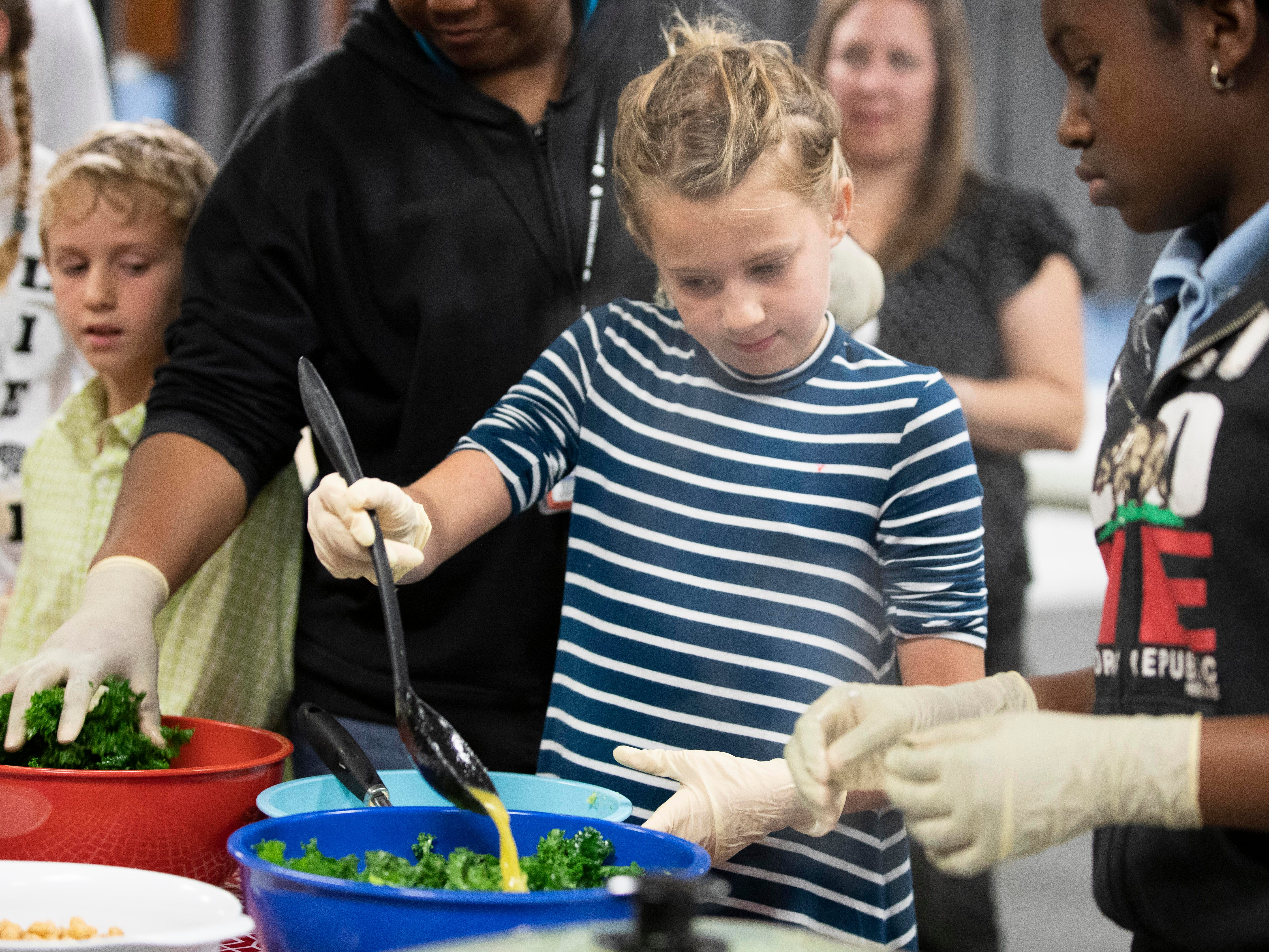 Marybeth Peña, a nurse program specialist with the Florida Department of Health-Martin County, taught a free, hands-on cooking class on Monday, Feb. 4, 2019, at the 10th Street Community Center in Stuart. Adults and children learned knife skills, kitchen safety, and how to prepare healthy, low-cost meals. At the end of the class participants ate the veggie brown rice bowls, fruit and sparkling water that they helped prepare. The program was open to all members of the public. The center has plans to continue the class.