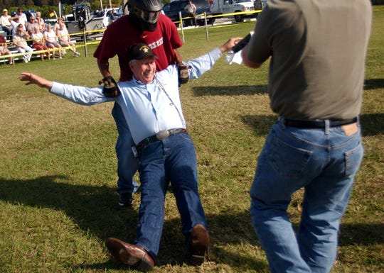 Indian River County Sheriff Roy Raymond, center,  is taken hostage in a mock-SWAT re-enactment during the 10th annual Florida Sheriffs Youth Ranches barbecue at the Indian River County Sheriff's Office in Vero Beach March 3, 2004.