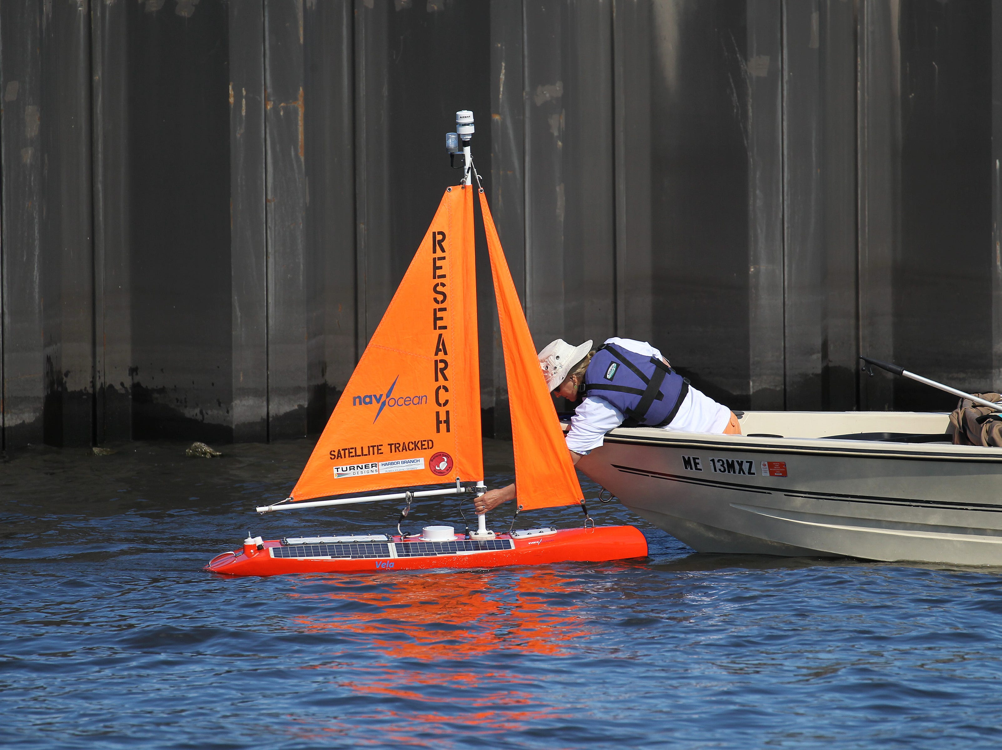 Launching of the Navocean Nav2 autonomous sailboat from the dock of the Pahokee Marina into Lake Okeechobee on Tuesday, Feb. 5, 2019, for a 10-day to two-week mission for search for and track blue-green algae blooms.
