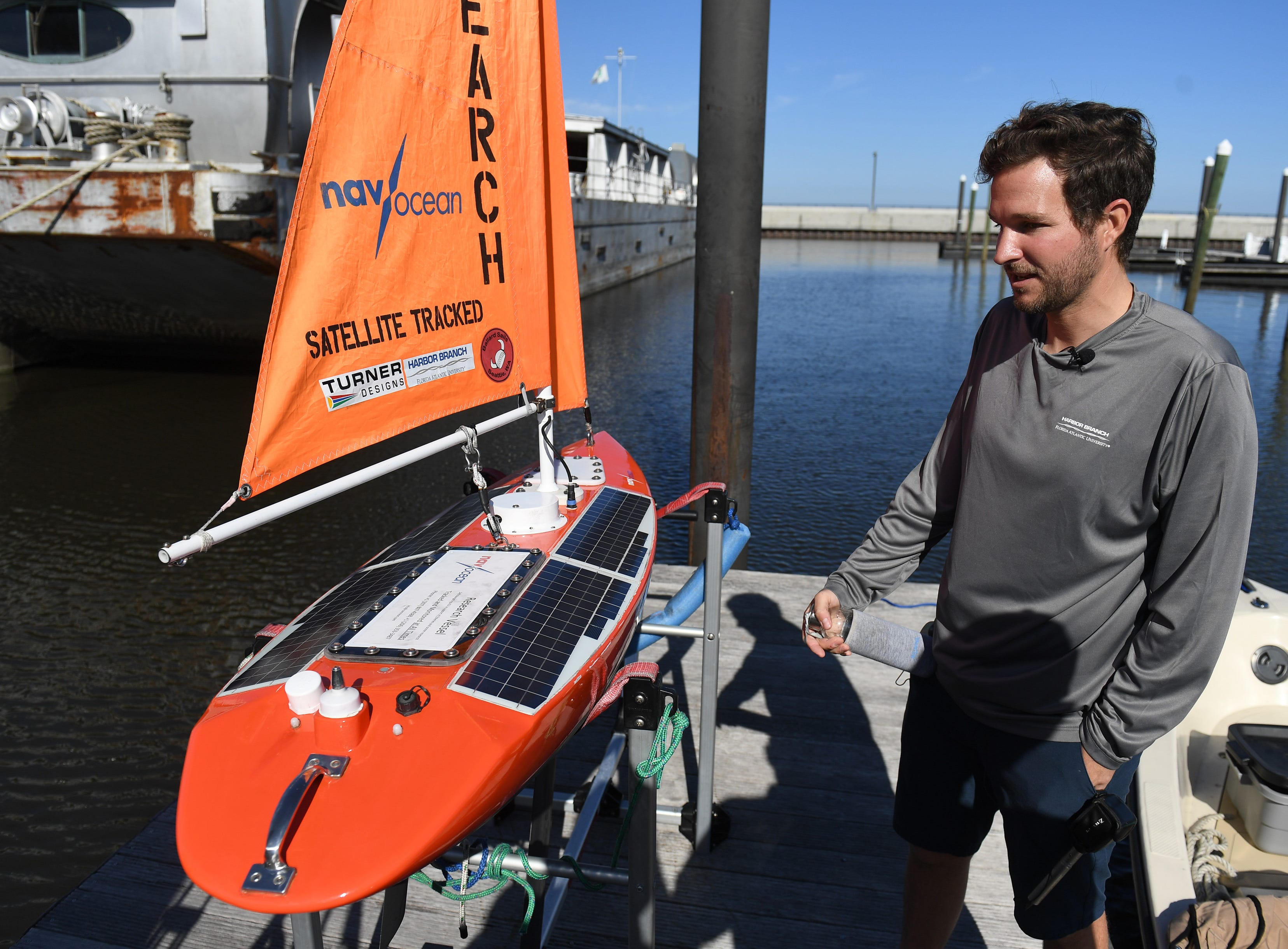 Jordon Beckler assists in launching of the Navocean Nav2 autonomous sailboat from the dock of the Pahokee Marina into Lake Okeechobee on Tuesday, Feb. 5, 2019, for a 10-day to two-week mission for search for and track blue-green algae blooms.