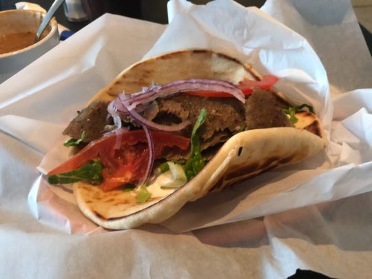 The lamb and beef gyro is tasty, especially with the Tzatziki sauce at the bottom.