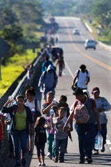 Honduras migrants, part of the caravan hoping to reach the U.S. border, walk on a road in Tapachula, Chiapas State, Mexico, on Friday, Jan. 18,2019. Hundreds of Central American migrants were walking and hitchhiking through the region as part of a new caravan of migrants hoping to reach the United States.