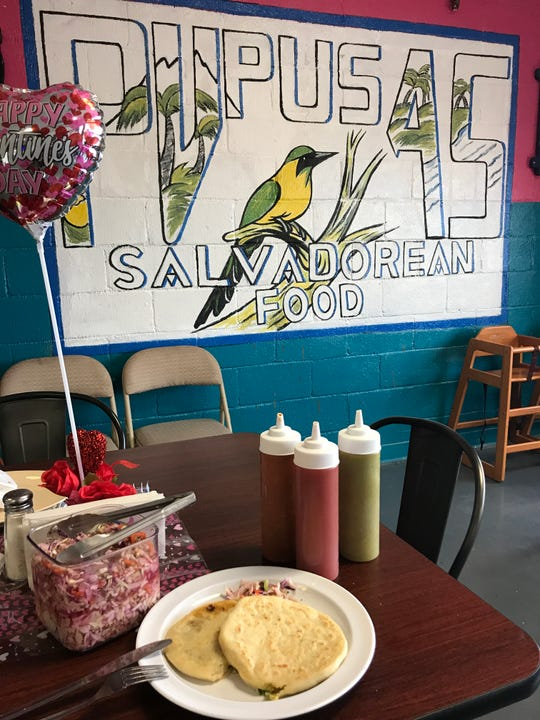 The pupusas can be ordered with a variety of stuffings. These are the Revuelta, which has a blend of pork rind, bean and cheese, and the squash filled one. The pupusas are served with curtido, a fermented cabbage relish.