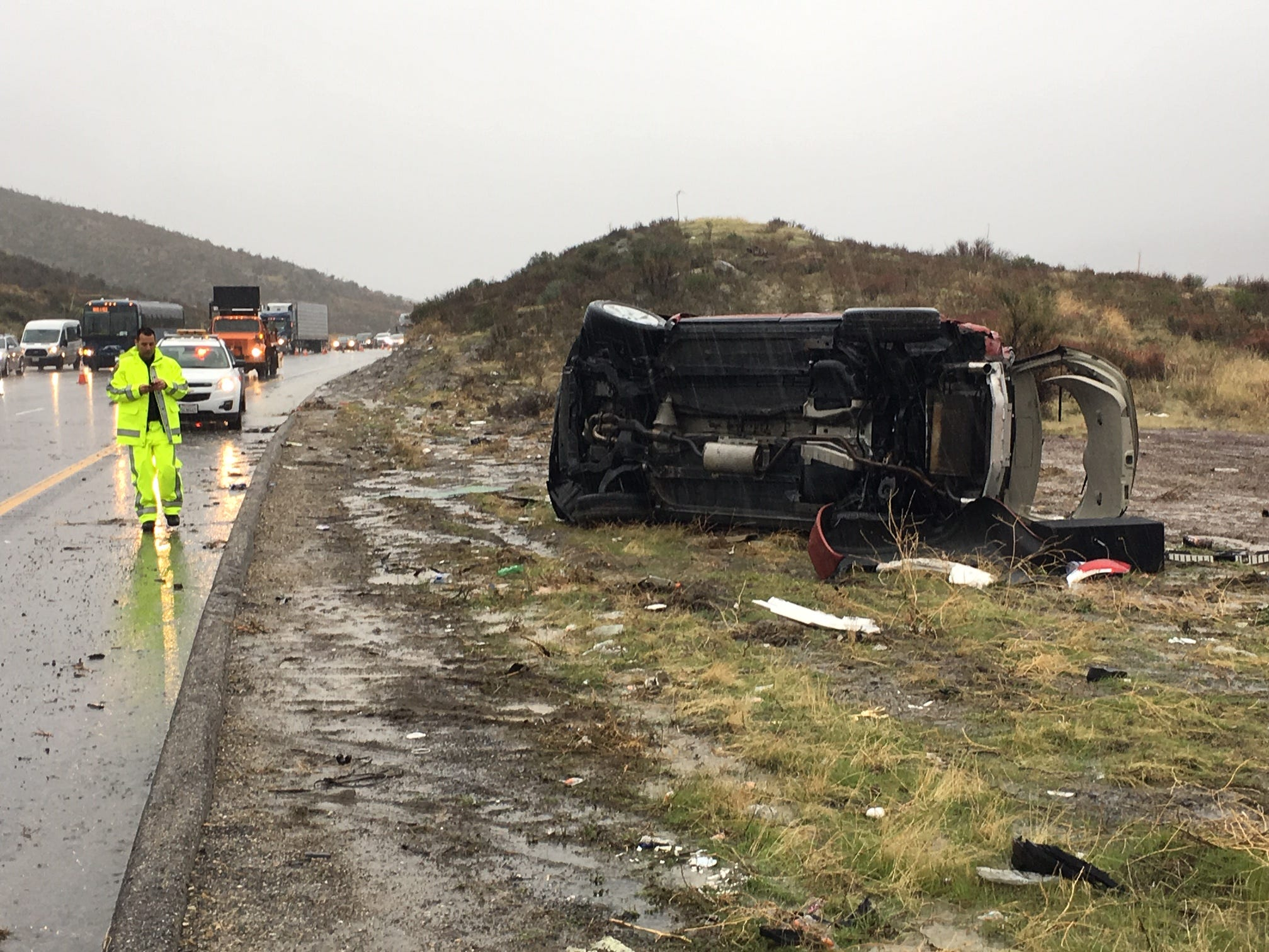 Members of a Ventura County Sheriff's search and rescue team had stopped on Interstate 5 Saturday morning to help  out after this Nissan Murano rolled over. One team member was killed and three were injured when another driver lost control of his SUV and plowed into the group, authorities said.