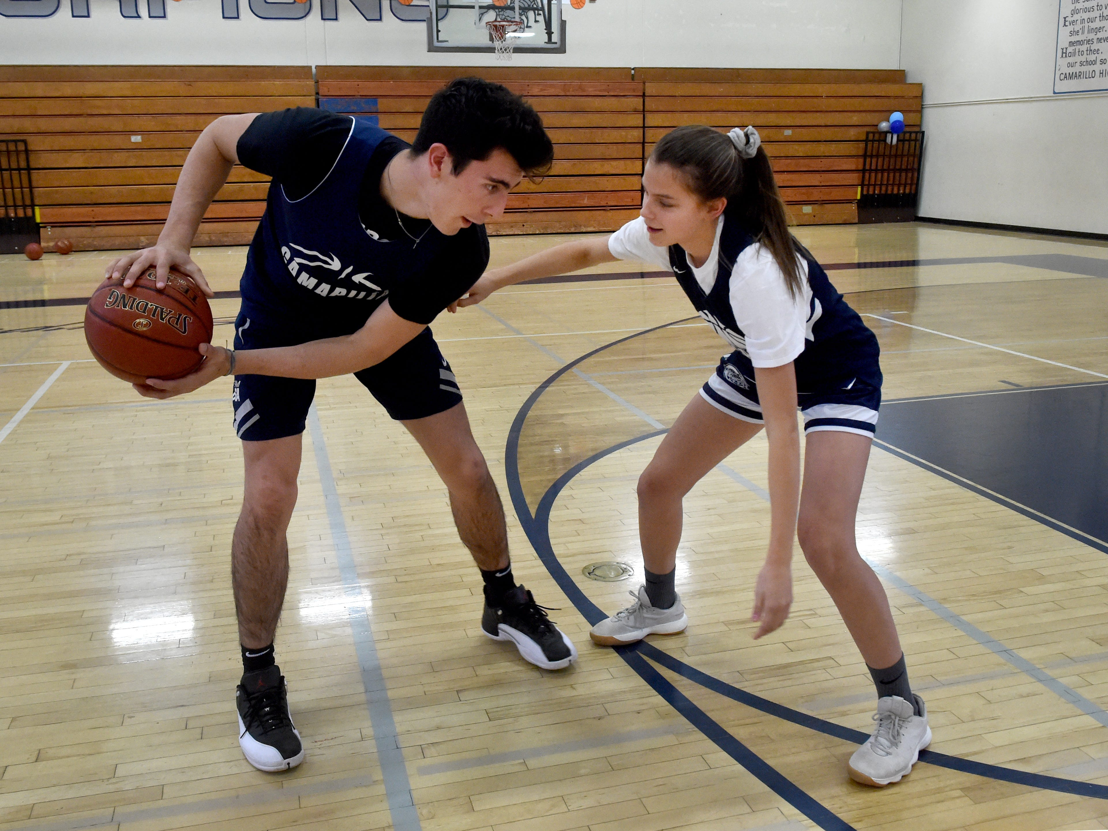 Jaime Jaquez Jr. goes one one with sister Gabriela, a freshman, at Camarillo High. Jaime, the star player for the boys basketball team, has been one of the top players in the state and is bound for UCLA, while Gabriella has made an instant impact on the varsity girls basketball team. Both Camarillo teams had dominant regular seasons.