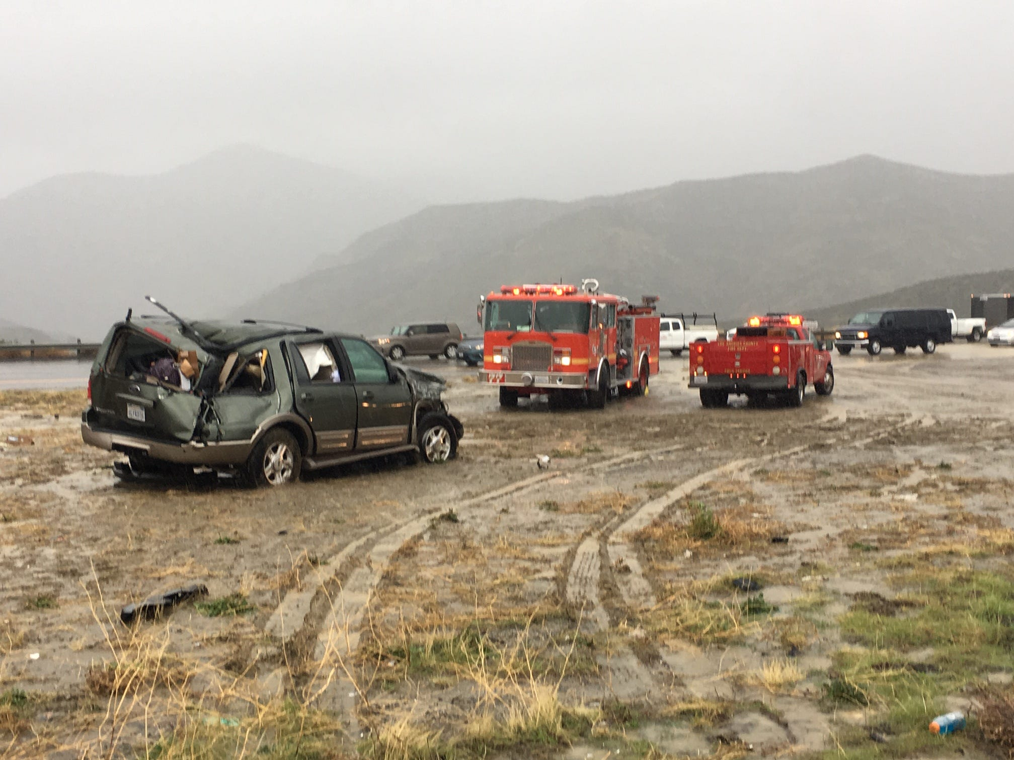 The Ford Expedition, left, that reportedly ran into a Ventura County Sheriff's search and rescue team comes to rest in a center median. The crash killed one team member and injured three, when the group had stopped to help at an earlier accident on Interstate 5 Saturday.