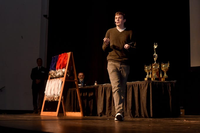 Sean Cunin, of Oak Park High School, gives his speech on the virtues of the coffee bean during the Ventura County Academic Decathlon awards ceremony in Oxnard on Monday.