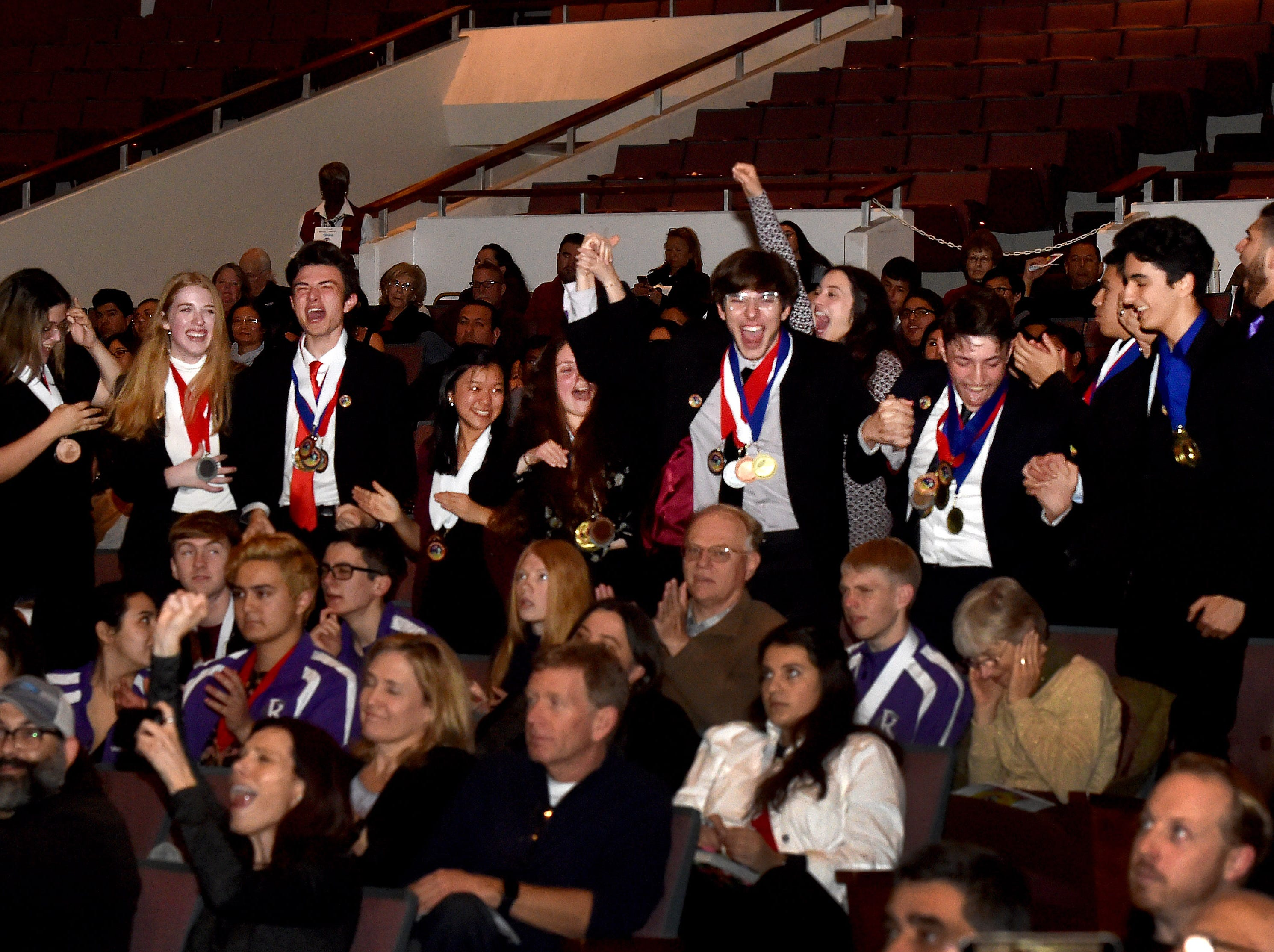 Students from Calabasas High School erupt into cheers as they are named the winners of the Ventura County Academic Decathlon for the third year in a row at the awards ceremony in Oxnard on Monday.