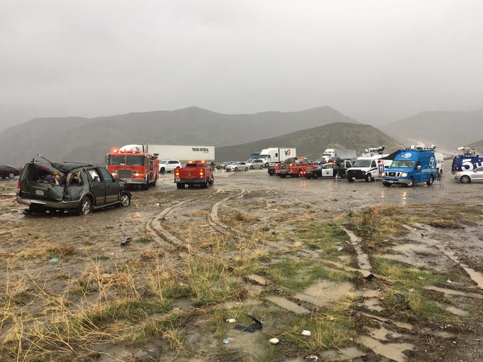 The scene at Saturday's fatal accident on Interstate 5 where a Ford Expedition, at left, reportedly lost control and rammed into members of a Ventura County Sheriff's search and rescue team in the median who were helping the victim of an earlier crash, authorities say. One team member died and three others were injured.