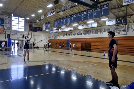 Gabriela Jaquez, who has been one of the top players for the girls basketball team in her freshman season, takes some shots while her older brother Jaime, one of the top boys basketball players in the state, looks on at Camarillo High.
