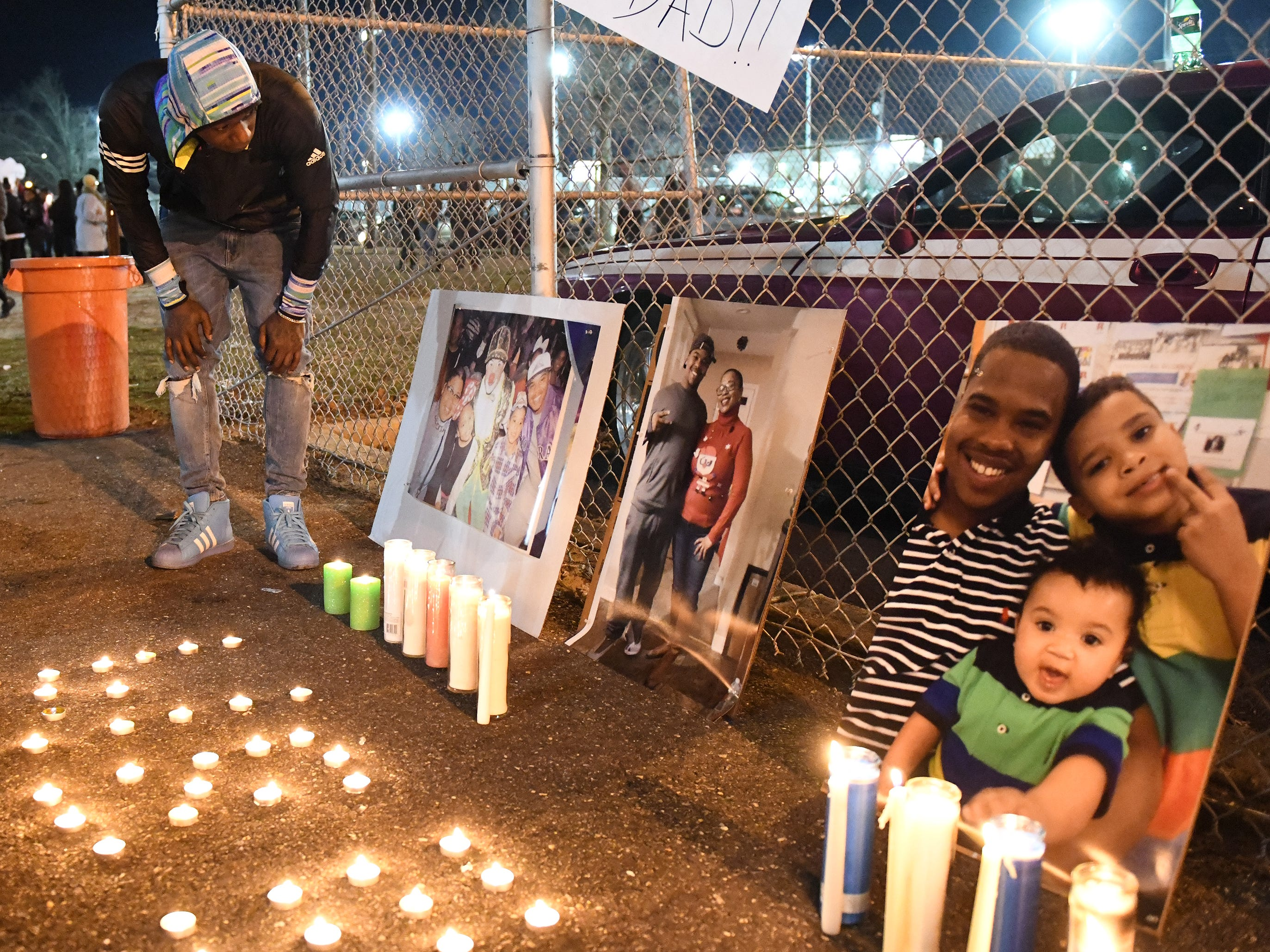 Family and friends gather at the Vineland Midget Football League grounds during a candlelight vigil for 32-year-old Walter L. Brown III. Brown was fatally shot during a reported home invasion last week.