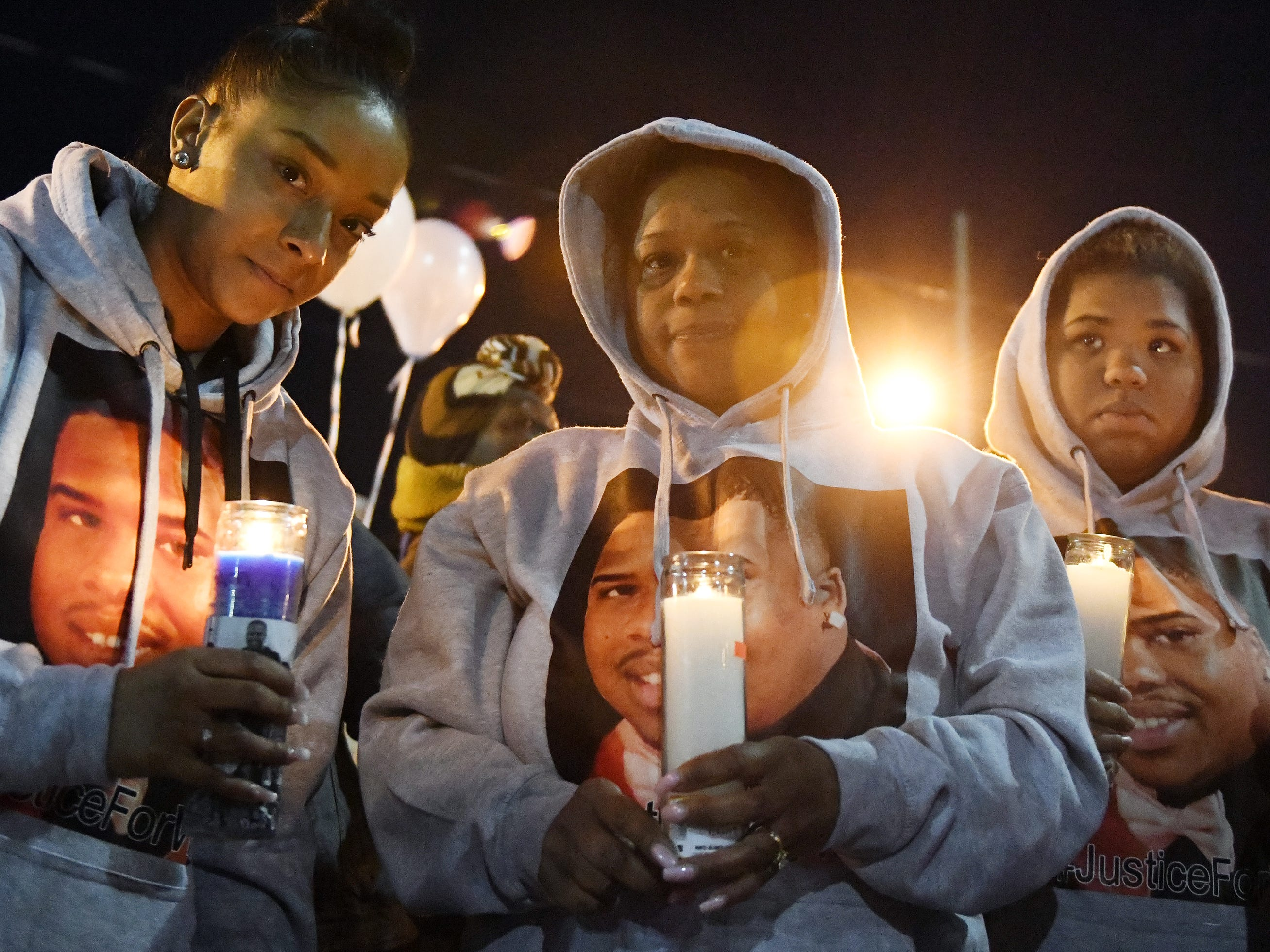 Family members surround Kenthy Street, the mother of 32-year-old Walter L. Brown III, in support during a vigil at the Vineland Midget Football grounds on Monday, Feb. 4, 2019.