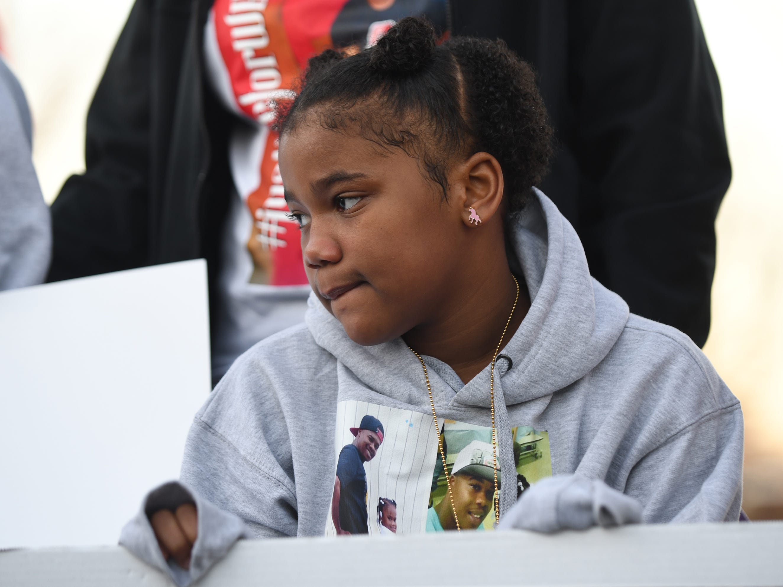 Walter L. Brown's daughter Amani attends a vigil for her father at the Vineland Midget Football grounds on Monday, Feb. 4, 2019.