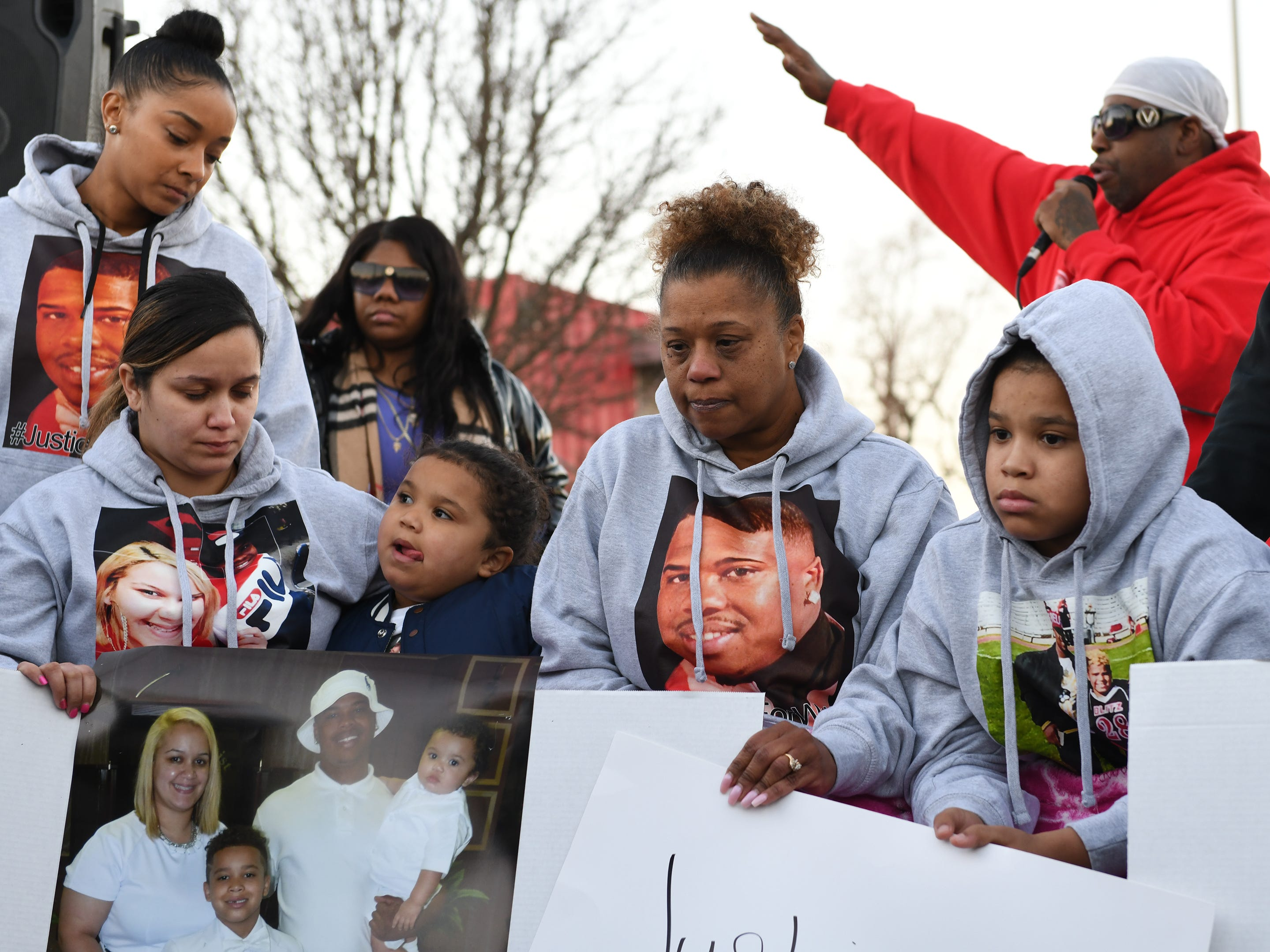 Walter L. Brown's family listen to Jeff Lindsey speak during a vigil at the Vineland Midget Football grounds on Monday, Feb. 4, 2019. Brown was fatally shot during a reported home invasion last week.