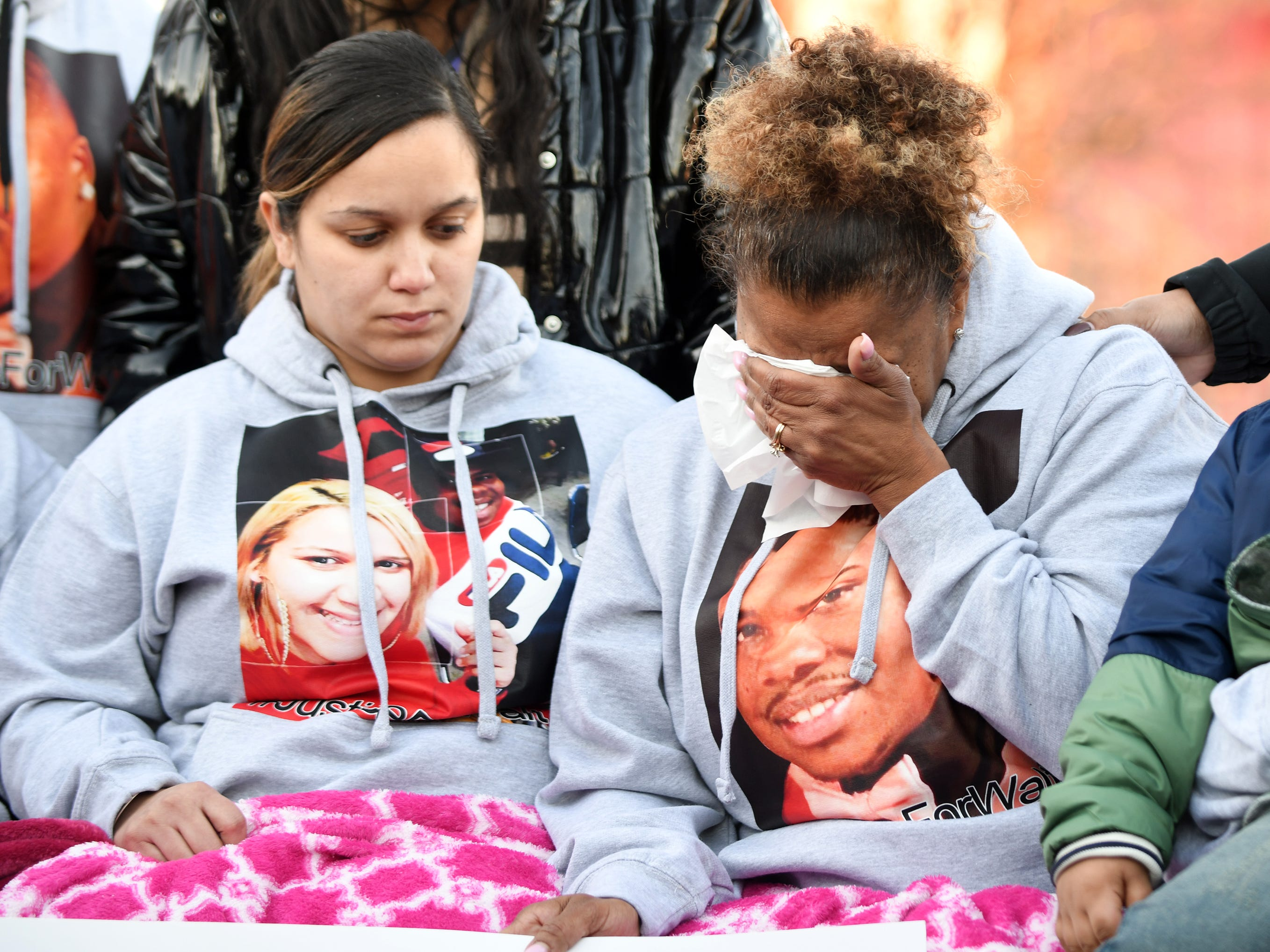 Carmen Rosario (left), longtime companion of Walter L. Brown, and Kenthy Street, Brown's mother, comfort each other during a vigil at the Vineland Midget Football grounds on Monday, Feb. 4, 2019.