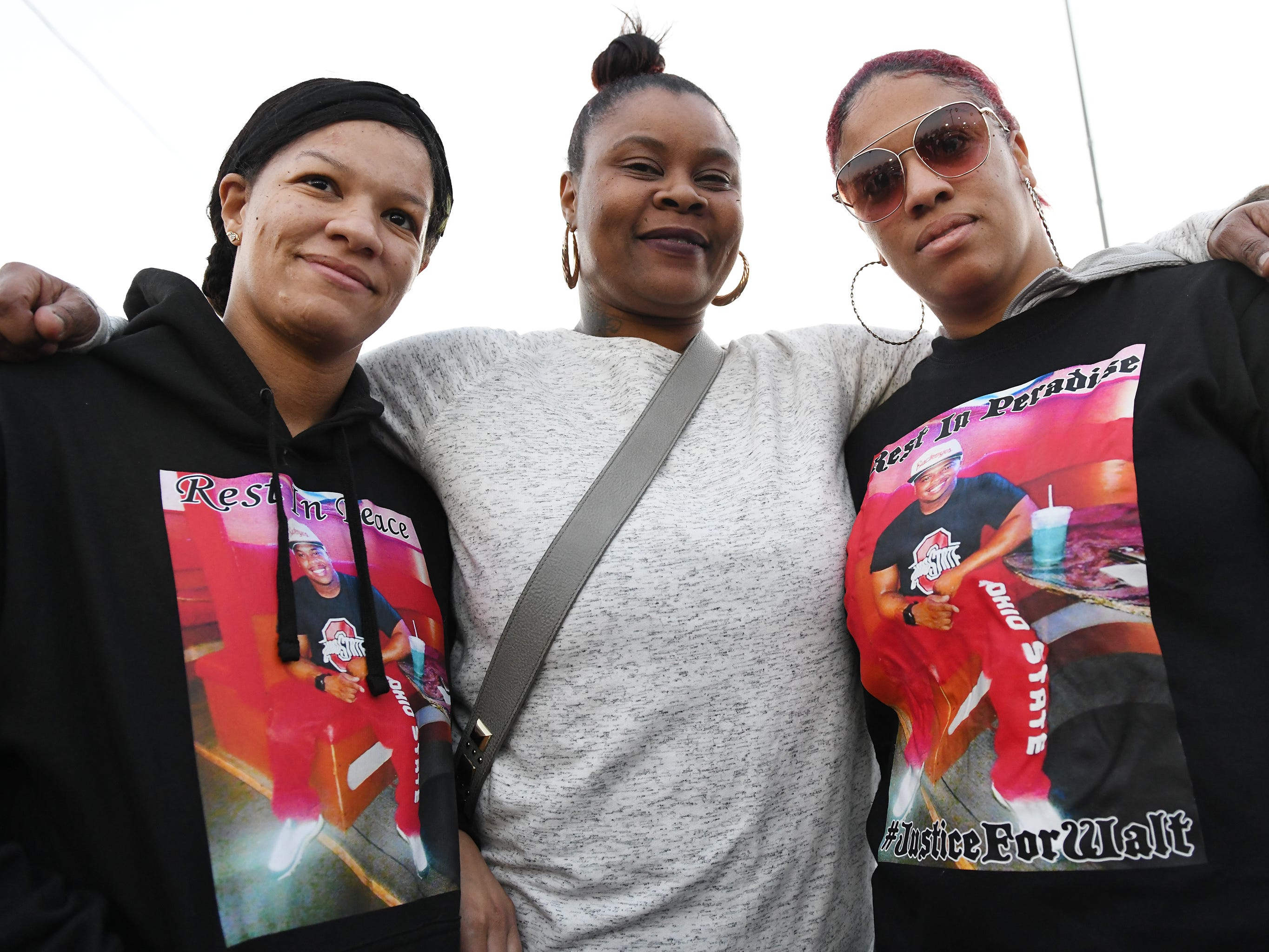 Ashley Cobbs (center) and sisters Daneen (right) and Iyana Winchester attend a vigil for 32-year-old Walter L. Brown III on Monday, Feb. 4, 2019 in Vineland.