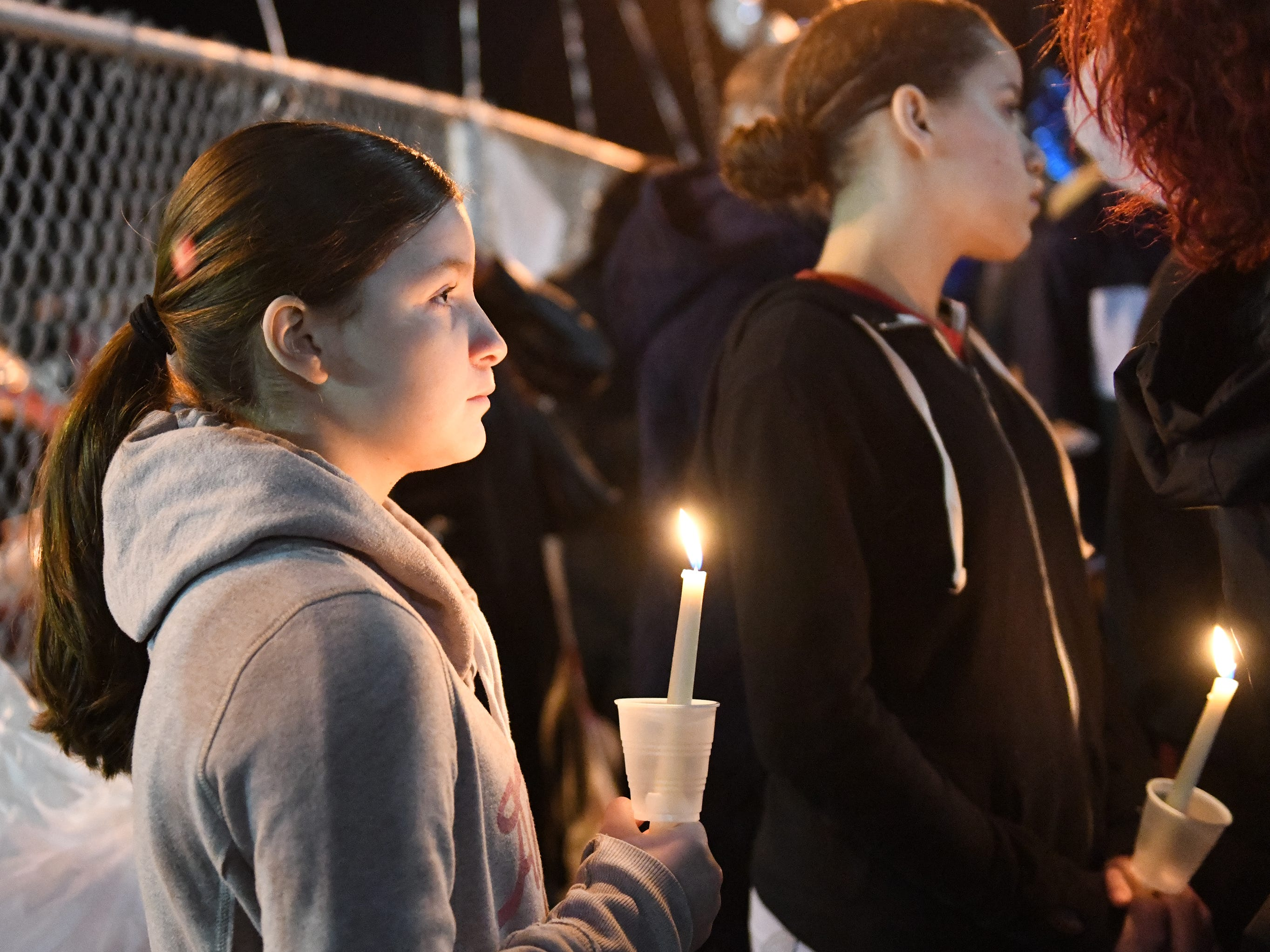 Family and friends gather at the Vineland Midget Football League grounds during a vigil for 32-year-old Walter L. Brown III on Monday, Feb. 4, 2019. Brown was fatally shot during a reported home invasion last week.