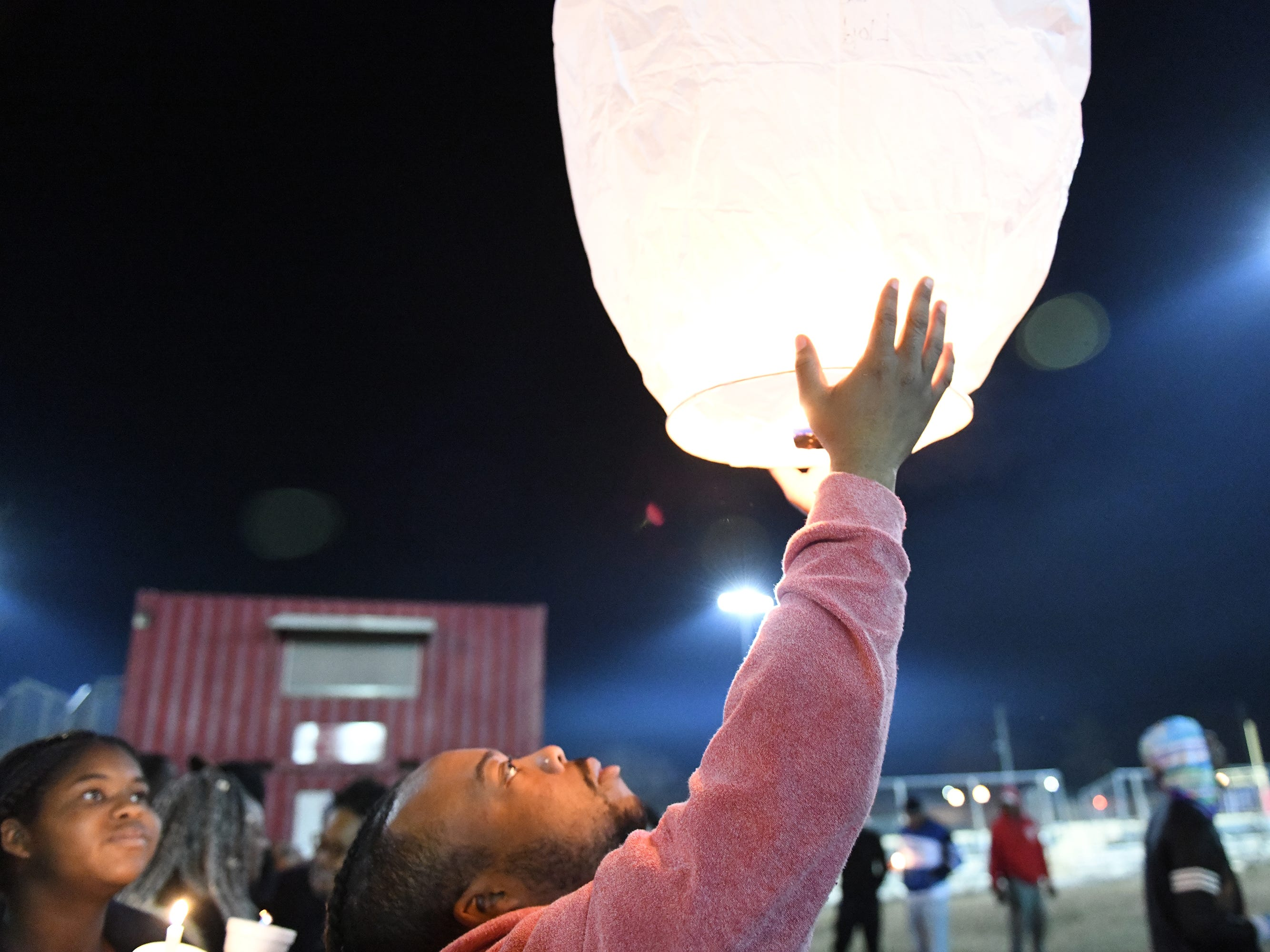 Balloons are set free at a vigil for 32-year-old Walter L. Brown III at the Vineland Midget Football grounds on Monday, Feb. 4, 2019.