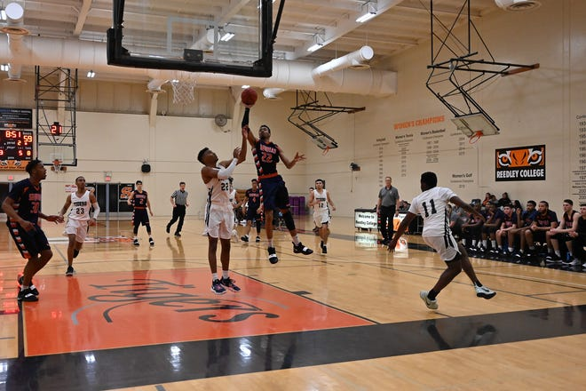 College of the Sequoias' basketball player Elihu Cobb plays against Reedley College on Monday.