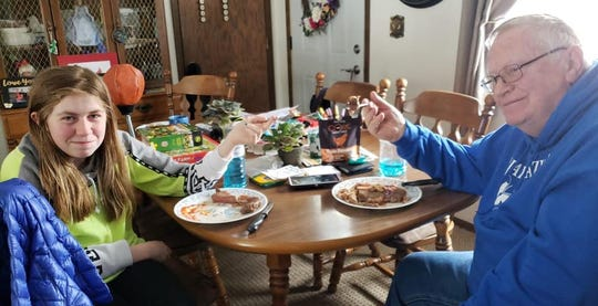 Jayme Closs eats a steak with her grandfather weeks after she escaped from Jake Patterson in northern Wisconsin.