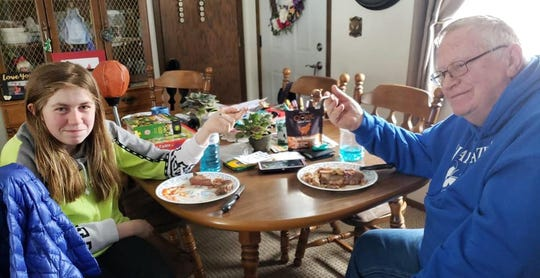Jayme Closs eats a steak with her grandfather Sunday.