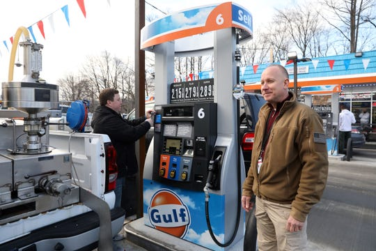 James Elcik, right, Rockland's new director of consumer protection, looks on as consumer services inspector Kevin Guiney checks a gas station in New City Feb. 5, 2019.