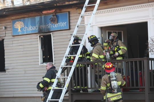 Bedford Hills firefighters along with mutual aid from other departments, work at the scene of a fire at the Chabad Jewish Center on Railroad Avenue in Bedford Hills Feb. 5,  2019.