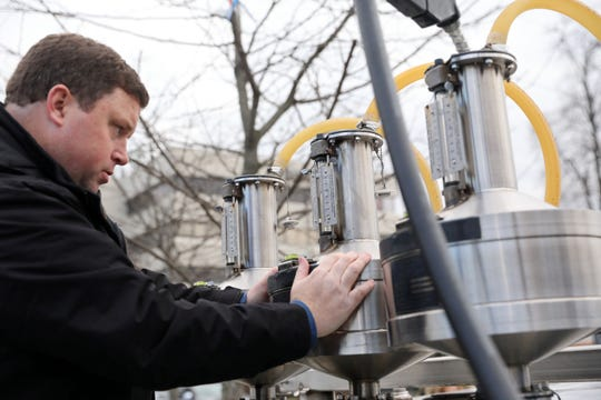 Consumer services inspector Kevin Guiney checks a gas pump for accuracy at a gas station in New City Feb. 5, 2019.