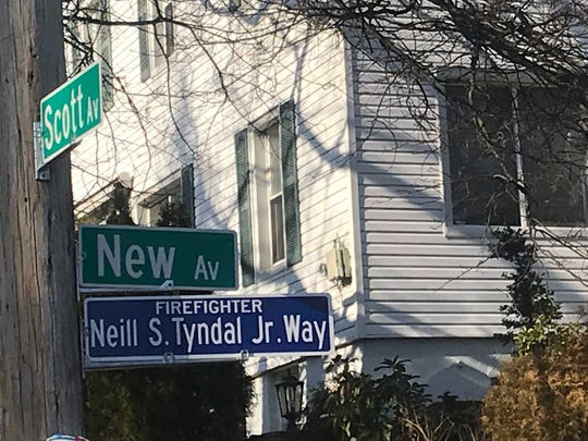 The new street sign honoring former Yonkers firefighter who died in 2017 of 9/11 related illness
