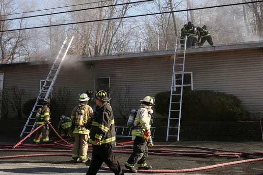Bedford Hills firefighters with mutual aid from neighboring departments, work at the scene of a fire at the Chabad Jewish Center on Railroad Avenue in Bedford Hills Feb. 5, 2019.
