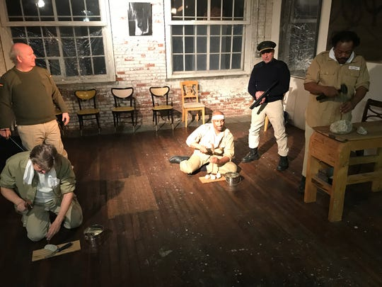 "Left to right: Richard Troiano (kneeling) Rick Levi (standing), Steve Allen (kneeling) John DeBlasio (background) Keith Bulluck (standing), in a scene from ""Antigone on Robben island: Mandela Takes the Stage."""