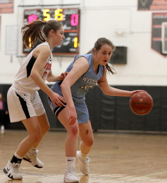 Rebecca Lovett of Westlake controls the ball while being defended by Grace Reyer of Croton during a varsity basketball game at Croton High School Feb. 4, 2019. Lovett competes in basketball despite having a heart defect. She had a pacemaker inserted in her chest when she was four years old.