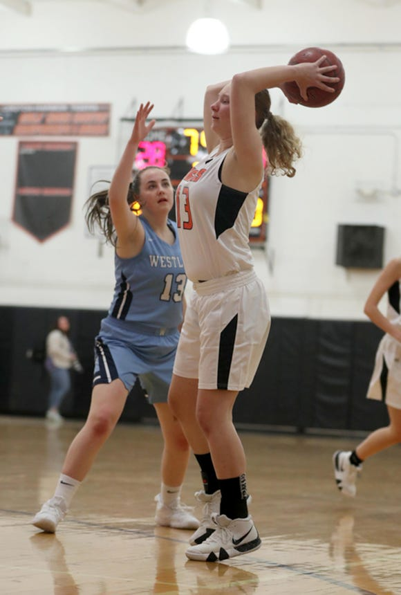 Rebecca Lovett of Westlake defends Erin Reynolds of Croton during a varsity basketball game at Croton High School Feb. 4, 2019. Lovett competes in basketball despite having a heart defect. She had a pacemaker inserted in her chest when she was four years old.