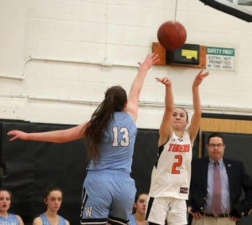 Anna Eng of Croton hits a three-pointer over Rebecca Lovett of Westlake during a varsity basketball game at Croton High School Feb. 4, 2019. Croton defeated Westlake 50-37.