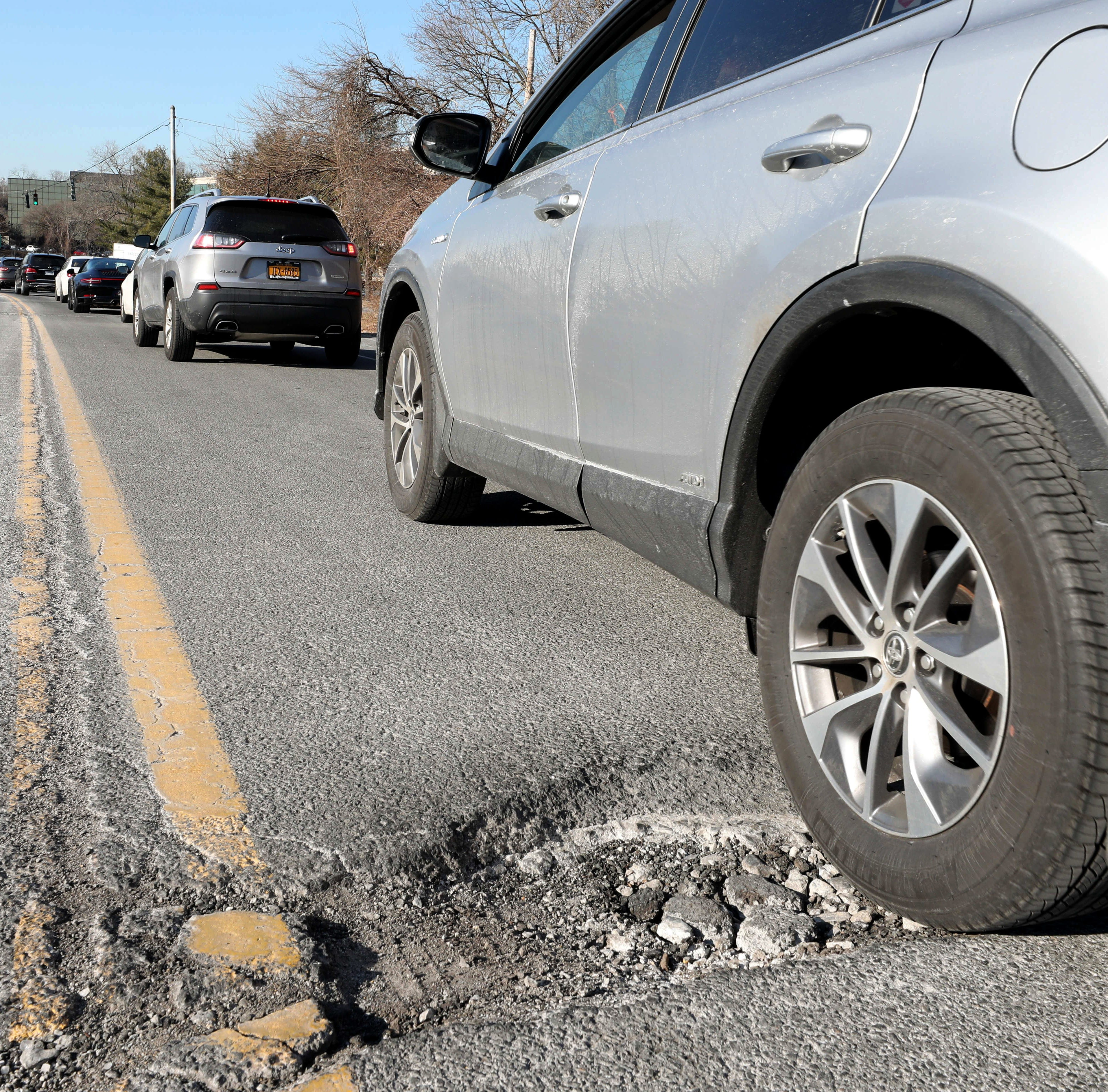 A large pothole is pictured along Webb Avenue in Harrison, Feb. 5, 2019.