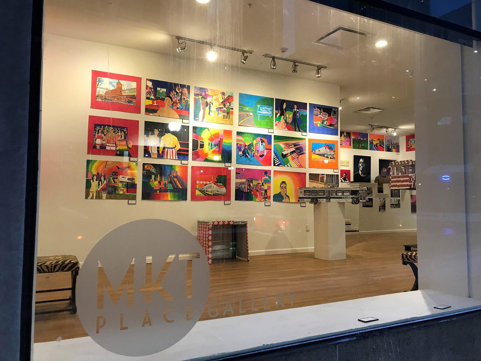 Geraldo Gonzalez's works glow in the light through the MKT Place gallery on Market Street in Wilmington.