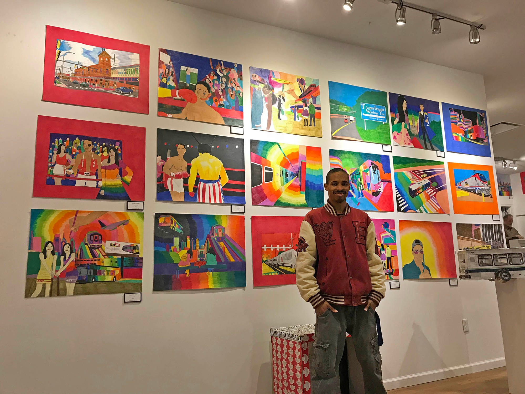 Geraldo Gonzalez, who often focuses on Wilmington's bus system, poses with a wider range of his work at an exhibit on Market Street.