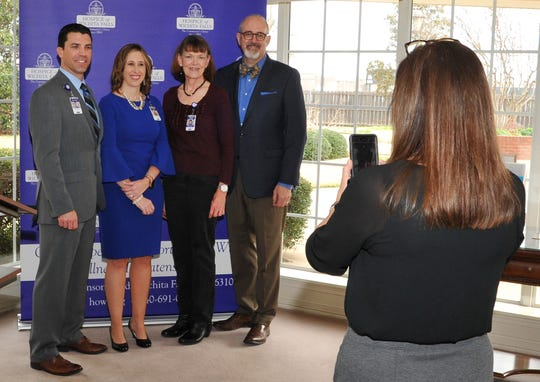 From left: Hospice of Wichita Falls, director of development, Jake Truette, executive director, Alisa Echols, medical director, Dr. Barbara Murphy, and associate medical director, Dr. Robert Parkey pose for a photograph after a press conference announcement Tuesday morning.
