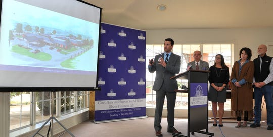Hospice of Wichita Falls, director of development, Jake Truette, centered, shows an artist rendering of the new patient care center during a press conference announcing the groundbreaking for the construction new facility Tuesday morning.