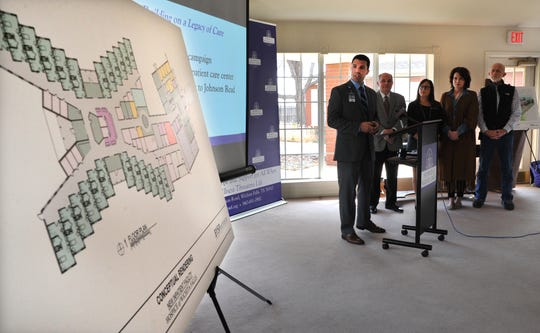 Hospice of Wichita Falls, director of development, Jake Truette shows conceptional floor plan of the new patient care center during a press conference announcing the groundbreaking for the construction new facility Tuesday morning.