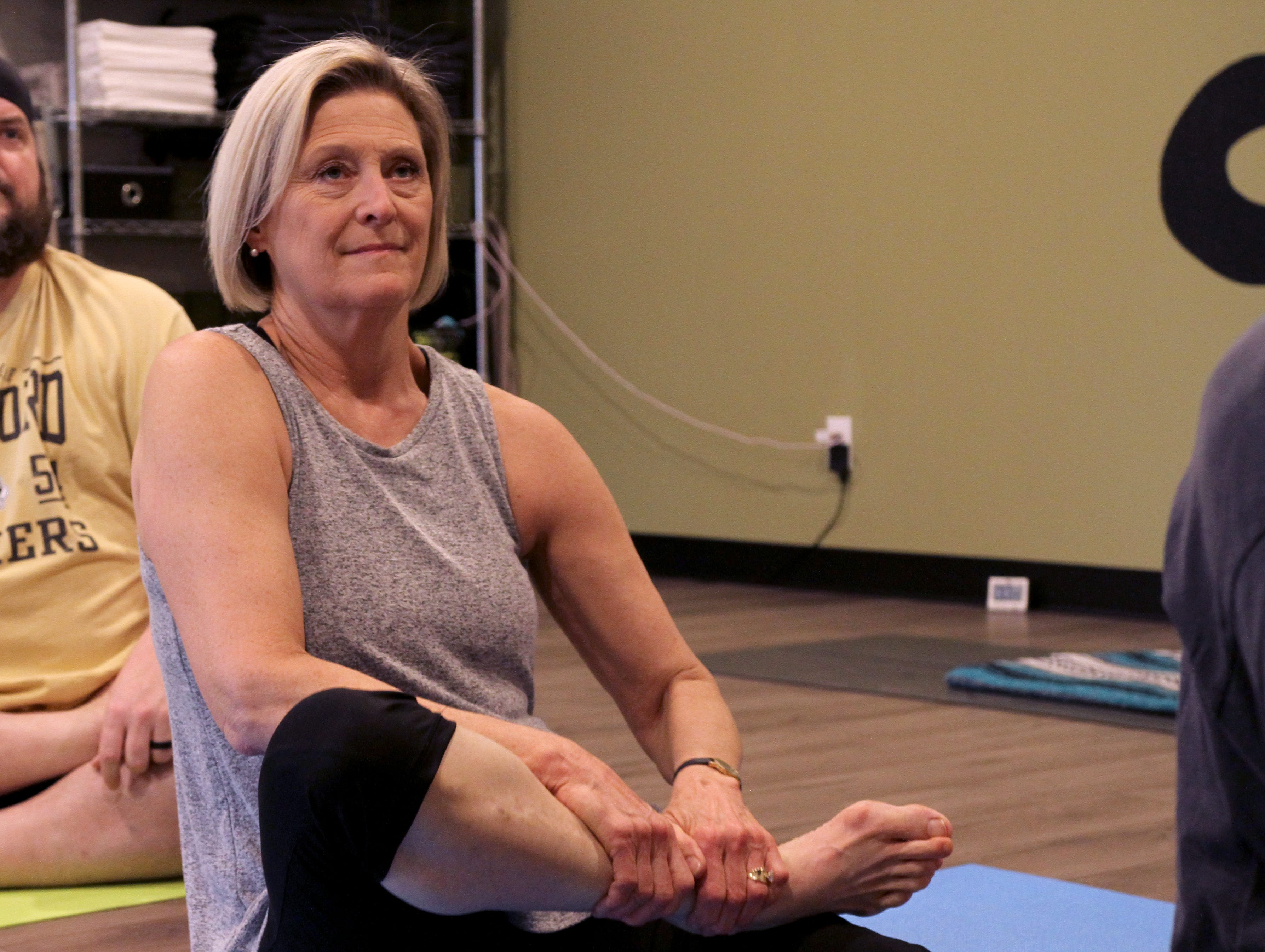 Lauren Nitschke gets into a pose during a session at Deep in the Heart yoga studio.